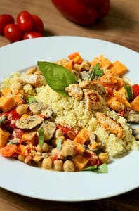 Couscous pan with vegetables, chicken and coconut sauce