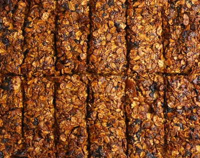 After the flapjacks have cooled down, they are cut into the right shape with sharp knives, and here you go - bite-sized flapjacks that fit in every pocket!...