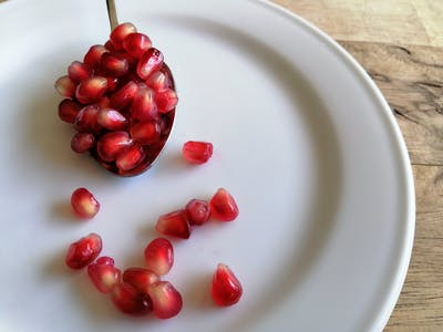 If you decide to buy fresh pomegranates, you should know how to extract the seeds. A nice trick is to gently beat the halved fruit with a spoon.