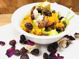 Pumpkin and black bean salad with orange and tahini dressing