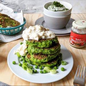 Pea and mint patties with apple and horseraddish cream served with cucumber salad.